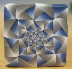 Raw intricate polymer clay cane: blue and grey fractal design. $15.00, via Etsy.