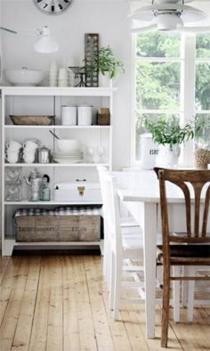 Shelves with baskets.  Nice neutral pallette