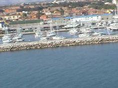 Il porto di Fano dall'alto di un deltaplano a motore