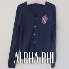 """Navy Alpha phi sweater Navy American Apparel cardigan with Alpha Phi embroidered crest in silver and Bordeaux of course. Button down. Long sleeve. Banding at hem and cuffs. V-neck. Slightly oversized fit.  100% combed cotton, machine wash.  Size small. Measures 17.5"""" in bust and waist, 23"""" neck to hem.  Like new condition. So cute and collegiate! Reasonable offers accepted! Alpha Phi Sweaters Cardigans"""