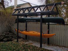 Kayak canoe sup storage racks . Kayak, sup and canoe storage racks protect by suspending your kayaks, canoes and sups with suspenz kayak storage ra. Surfboard Storage, Kayak Storage Rack, Kayak Rack, Boat Storage, Kayak Camping, Canoe And Kayak, Kayak Fishing, Kayaking Gear, Fishing Pole Storage