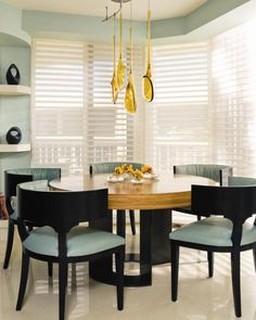 Rooms - Contemporary Curves   Palm Beach Illustrated Verónica Volani Inza, ASID, designed this modern breakfast room to have a comfortable and inviting feeling at all times. The elegant Antoine Proulx zebrawood table with bronze metallic legs.