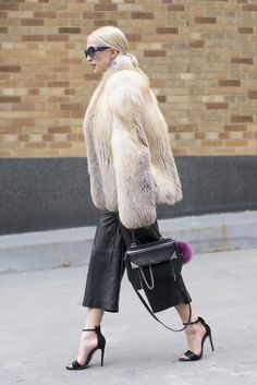 Add a touch of glamour with a fur coat and leather culottes.