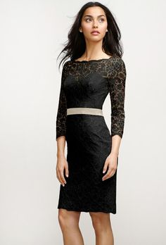 Nothing says elegance quite like a little black dress. Plus this Watters number with long lace sleeves keeps you warm while looking cool!