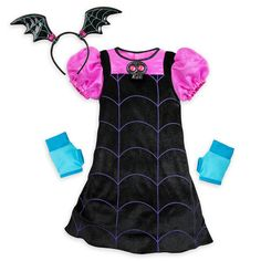 Your ghoul will go batty for dressing up as Vee! This velvet costume features a bat ear headband, gloves, and a skull that sings the Vampirina song.