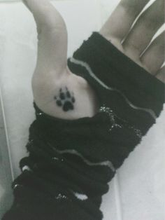 Wolf paw print tattoo, though if I were to get it on my hand, I think I would put it on either the back of my hand (symbolizing the wolf within) or the inside of my wrists.
