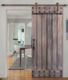 How cool are rolling barn doors? I love the light wood of this barn door, it really compliments the light colors of this home. Add some rustic charm to your home by installing a rolling barn door! If you're looking for more wall decor ideas, check out the blog at RugKnots http://blog.rugknots.com/interior-tips-and-tricks/interior-design/26-wall-decor-ideas/?preview_id=2493&preview_nonce=f5fecf75e7&post_format=standard&preview=true
