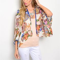Beautiful shorter length bright color kimono! Such a gorgeous piece with blues - pinks and yellow floral print- dolman 3 qtr sleeves- piped in Royal blue- stunning! Other
