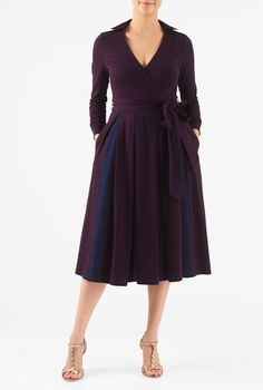 Faux-wrap styling accentuates the curve-flattering fit of our two tone cotton knit dress cinched in with a removable sash tie belt at the banded waist.