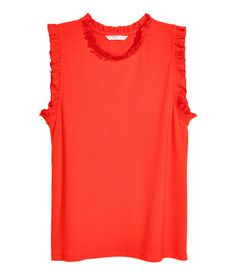 $7.99 Red. Sleeveless top in soft, ribbed jersey with narrow ruffle trim at neckline and armholes.
