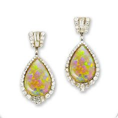 A pair of opal and diamond pendent earrings    Each drop-shaped water opal set within a graduated border of old brilliant-cut diamonds, accented with three tapered baguette-cut diamonds in fan formation, suspended from a geometric surmount set with similarly-cut stones, diamonds approximately 2.80 carats total