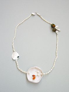 """""""Found pleasure"""" by Ananda Ungphakorn. 2006. Bone china, fine silver, dried flowers, precious gemstone and freshwater pearl."""