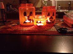 Halloween pumpkin lanterns Made with repurposed glass jars and mod podge colors!