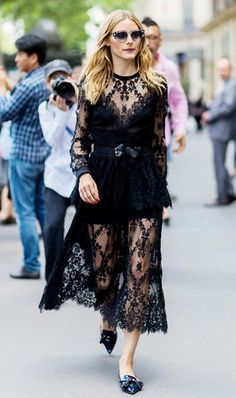 Olivia Palermo looks absolutely stunning in a black lace midi dress, belted and styled with a pair of pointy loafers to keep it casual enough for day time
