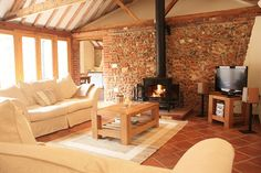 This stunning barn conversion is nestled in the picturesque village of Bale, four miles from the coast. Check availability for Dairy Barn and book her. Barn Living, My Living Room, Living Area, Barn Conversion Interiors, Barn Conversion Bedroom, English Cottage Interiors, Design Lounge, Oak Framed Buildings, Converted Barn