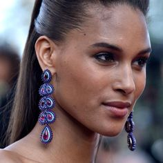 Cindy Bruna wearing white gold, titanium, rubellite tourmaline, amethyst and paraiba tourmaline earrings from the Chopard Red Carpet Collection at the premiere of Julieta in Cannes