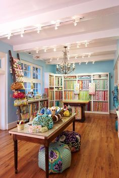 Office/Craft Room...oh, the lighting!  Lots of good ideas here.  Bolts shelves, glass top table, quilt ladder...