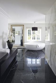 marble is a glam and luxurious material, so using it for decor is a great idea, and add a large mirror