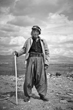 A Kurdish shepherd working in the outskirts of Sulaimaniyah city, Iraq; Photo by Joe Murray