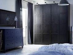 PAX black-brown wardrobe with HEMNES black-brown doors and HEMNES blue chest of drawers and black-brown mirror