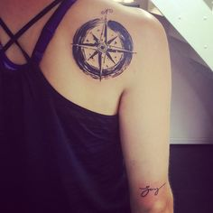 "Enso with compass - life's journey. Enso: when the mind is free, the soul can create. An unfinished life. Compass: pointed in all directions but reminder of Who is my true north. [plus, tiny ""joy"" tattoo] - Melanie Spring's tattoos in Aarhus Denmark"