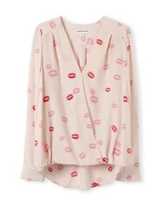 Make a statement with this Lip Print Silk Wrap Shirt from the Woolworths Country Road range