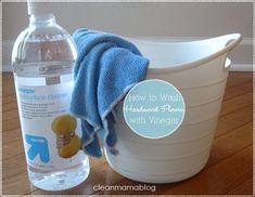 Wash hardwood floors with white vinegar and water. The vinegar removes residue built up from other cleaners that attract dirt. The correct ratio is 1/2 cup white vinegar to 1 gallon warm/hot water.