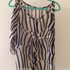 Open shoulder blouse Size medium. Open cut out shoulder.  Sheer and flowy. Tops Blouses