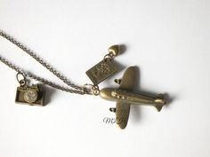 Bronze Lovely Airplane Passport Necklace with by MiaLovelyHandmade #fashion #stones #stone #crystal #tourquoise #gems #gemstone #summer #necklace #jewellery #jewelry #jewels #bijoux #pendant #charm #luxury #love #earrings #bracelets #lovely #woman #girl #gift #blue #crystals #gems #starfish #anchor #bracelets #bracelet #accessories #jewelry #jewels #bijoux #travel #photo