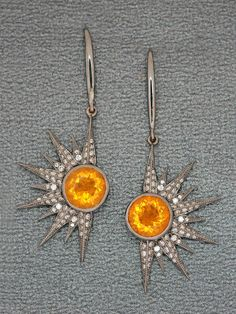 Stop it! Just forget you ever saw these! Colette Round Opal Sunburst Earrings at London Jewelers.