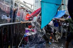 Pro-democracy demonstrators are sprayed with pepper spray during clashes with police officers during a rally near the Hong Kong government headquarters on Sept. 28, 2014. Xaume Olleros—AFP/Getty Images