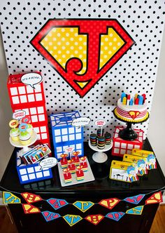 {Budget Friendly} Comic Book Style Super Hero Party  CD crates turned upside down with white cardstock placed inside for buildings.