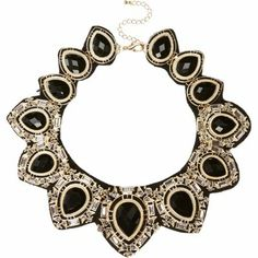 { Black fabric backed statement necklace }