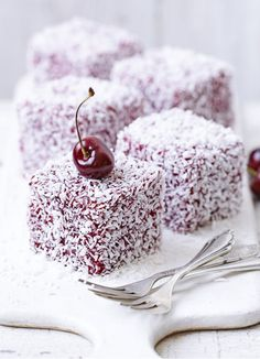 Lamingtons, originally from Australia, make a delicious teatime treat. Mini cakes, decorated in cherry jam and desiccated coconut, topped with a fresh cherry.