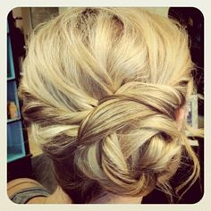 twisted and braided side bun- summer updos... there arnt any instructions :( but i shall let you enjoy it and pick it apart in order to find out how if you please... uber cute though :D