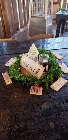 Reserve sign mini games lantern and greenery on wood slice on farm style table