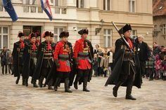Guardsmen of the Kravat Regiment in their winter dress uniforms preparing for the changing of the guard on St. Mark's Square in Zagreb, Croatia.