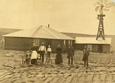 taken in 1884, and shows a Nebraska Farm Family. I like the ingenious set up they have for water . . . they actually built part of the house AROUND the windmill. This would allow them to have water in the house, and the warmth of the house would prevent the base of the windmill from freezing in very cold weather.