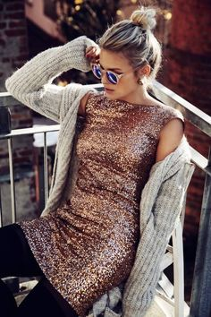 sequin dress and a warm cozy long knit cardigan along with cool aviator's.