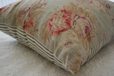 faded floral fabric used on front part and blue/white ticking cotton on back . octavi on etsy