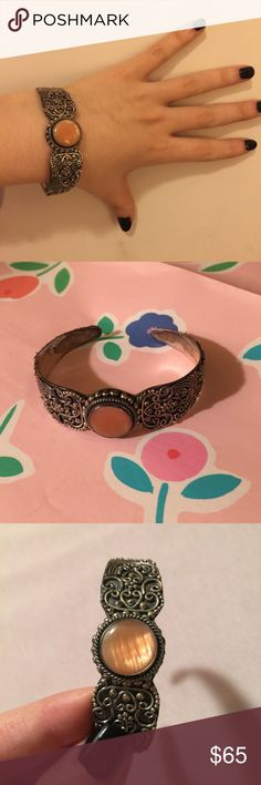 Peach Quartz & Silver Cuff Bracelet Marked 925 for Sterling silver. I believe the stone is peach Quartz. Bracelet is adjustable and can bend to fit your wrist. Very pretty! Jewelry Bracelets