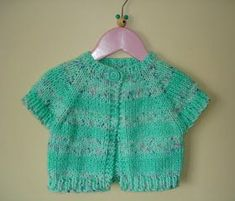 This cute baby shrug is easy and quick to knit. It will fit a baby of around 12 - 18 months. I made it from two balls of DK magic. Easy Baby Knitting Patterns, Shrug Knitting Pattern, Knit Cardigan Pattern, Knit Shrug, Baby Cardigan, Baby Patterns, Crochet Patterns, Knitting For Charity, Knitting For Kids
