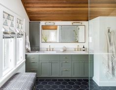 Bar lights provide bright, flattering light that's ideal for a main bath vanity. Exhibit A: our West Slope LED sconces in this bathroom designed by @heidicaillierdesign. We're sharing more tips on selecting bathroom lighting on our blog - link in profile. Photo by @haris.kenjar #myonepiece #bathroom #bathroomlighting
