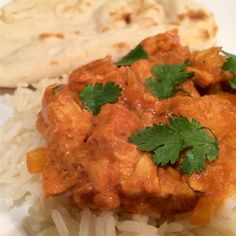 Slow Cooker Butter Chicken: Chicken thigh meat cooks with tandoori masala and garam masala in a sauce of coconut milk and tomato in this tasty Indian classic. Best Slow Cooker, Slow Cooker Recipes, Crockpot Recipes, Chicken Recipes, Cooking Recipes, Yummy Recipes, Recipies, Dinner Recipes, Naan
