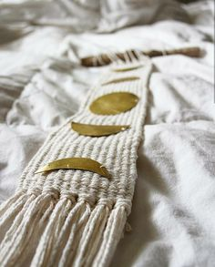 This is a beautiful golden moon phase on a white woven background made to order. The moons are hand cut from a brass sheet then sewn onto the cotton background. Is an amazing touch to any moon childs home :)  Be aware that this is made to order so it may take 1-2 weeks until its ready to ship.  Dimensions Nail to bottom - 2 feet 7 inches  Width of stick - 9 inches
