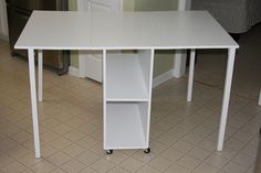 Compact folding fabric cutting table