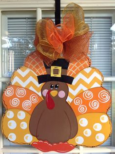 A new whimsical twist to another turkey of mine.    It measures 21 by 18 including bow. It is hand cut, and painted by me. All of my items are