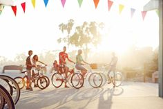 in love with this shot - sunset haze, colored flags, bikes, it's perfection.  tarawhitney.com