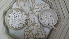 Porcelain pendants and beads in progress after bisc firing. Etsy Colorwheelstage store