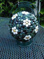 Gazing balls from bowling balls - an idea I first saw on HGTV. Garden art or garden junk - take a look and let me know what you think! #GazingBallsgarden #gardenjunk